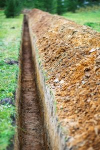 Conventional sewer repair involves digging long trenches. Trenchless technology avoids this.