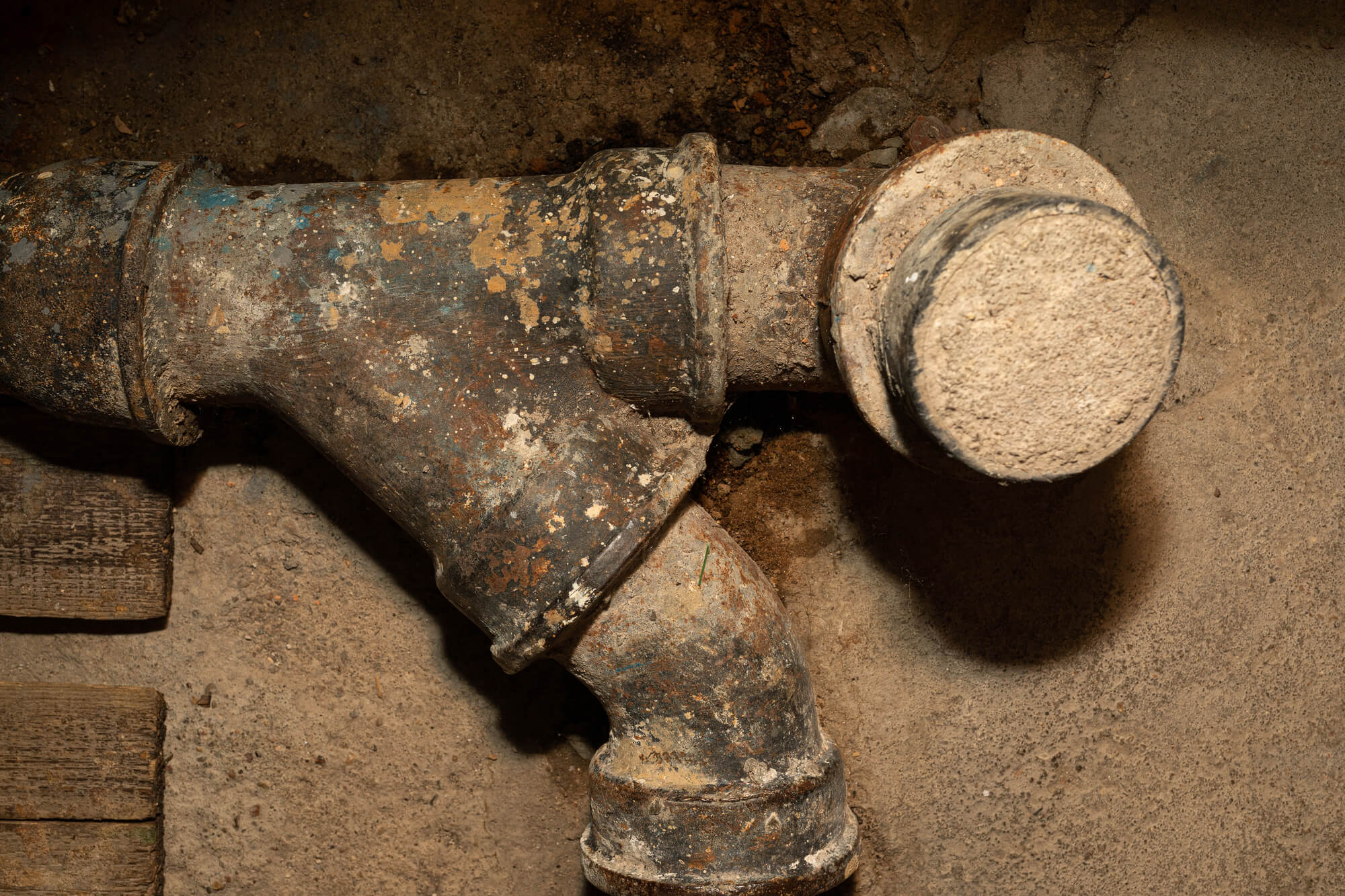 Old corroded sewage pipe in a beton wall