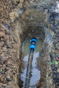 broken pvc pipe in trench leaks water after unsuccessfully repairs