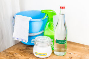 Baking soda and white distilled vinegar can help clean and eliminate sewer odor.