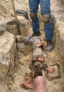 Man fixing a broken sewer line.