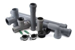 Assorted plastic sewer pipes.