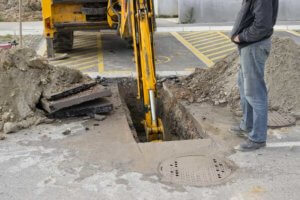 Digging a trench for sewer repair